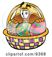 Hard Hat Mascot Cartoon Character In An Easter Basket Full Of Decorated Easter Eggs by Toons4Biz