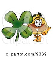 Hard Hat Mascot Cartoon Character With A Green Four Leaf Clover On St Paddys Or St Patricks Day