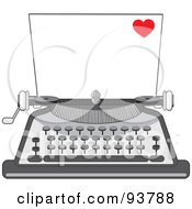 Blank Piece Of Paper In A Vintage Typewriter A Little Red Heart In The Corner