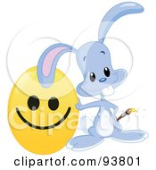 Royalty Free RF Clipart Illustration Of A Cute Blue Easter Bunny Leaning On A Happy Face Easter Egg