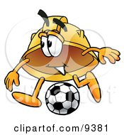 Clipart Picture Of A Hard Hat Mascot Cartoon Character Kicking A Soccer Ball by Toons4Biz