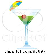 Cocktail Umbrella And Cherry In A Green Alcoholic Beverage