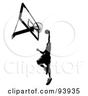 Royalty Free RF Clipart Illustration Of A Black Silhouetted Man Leaping Towards A Basketball Hoop