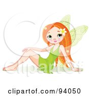 Pretty Spring Fairy In A Green Dress Sitting On The Ground