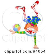 Clown Balanced On One Hand With A Ball On An Arm