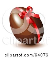 Shiny Red Ribbon And Bow Around A Chocolate Easter Egg