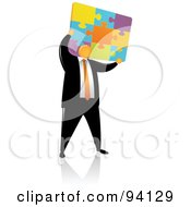 Royalty Free RF Clipart Illustration Of An Orange Faceless Businessman Holding Up A Colorfup Puzzle by Qiun