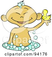 Asian Baby Holding Up A Rubber Duck In A Bubble Bath