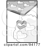 Black And White Heart Cookie Cutter Resting On Dough By A Cookie Sheet