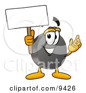Clipart Picture Of A Hockey Puck Mascot Cartoon Character Holding A Blank Sign