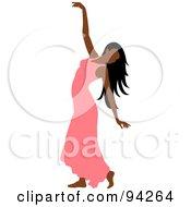 Graceful Hispanic Woman Dancing In A Salmon Pink Dress