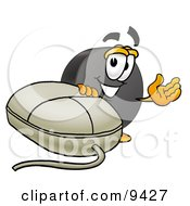 Clipart Picture Of A Hockey Puck Mascot Cartoon Character With A Computer Mouse by Toons4Biz