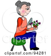 Senior Caucasian Woman Sitting On A Stool And Gardening