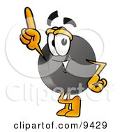 Clipart Picture Of A Hockey Puck Mascot Cartoon Character Pointing Upwards