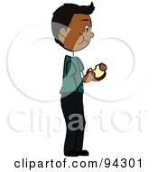 Hispanic Boy Standing And Eating A Sandwich