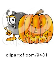Clipart Picture Of A Hockey Puck Mascot Cartoon Character With A Carved Halloween Pumpkin
