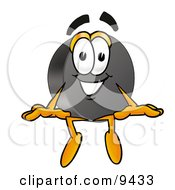 Clipart Picture Of A Hockey Puck Mascot Cartoon Character Sitting