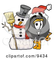 Clipart Picture Of A Hockey Puck Mascot Cartoon Character With A Snowman On Christmas by Toons4Biz