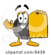 Hockey Puck Mascot Cartoon Character Holding A Yellow Sales Price Tag