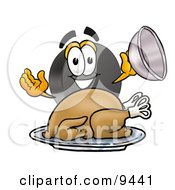 Clipart Picture Of A Hockey Puck Mascot Cartoon Character Serving A Thanksgiving Turkey On A Platter