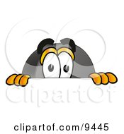Clipart Picture Of A Hockey Puck Mascot Cartoon Character Peeking Over A Surface by Toons4Biz