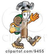 Clipart Picture Of A Hammer Mascot Cartoon Character Hiking And Carrying A Backpack