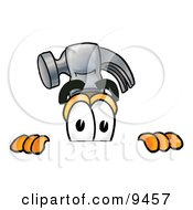 Clipart Picture Of A Hammer Mascot Cartoon Character Peeking Over A Surface by Toons4Biz
