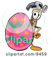 Clipart Picture Of A Hammer Mascot Cartoon Character Standing Beside An Easter Egg by Toons4Biz