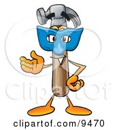 Clipart Picture Of A Hammer Mascot Cartoon Character Wearing A Blue Mask Over His Face by Toons4Biz