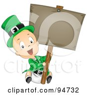 Leprechaun Baby Holding Up A Blank Wooden Sign