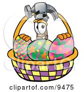 Clipart Picture Of A Hammer Mascot Cartoon Character In An Easter Basket Full Of Decorated Easter Eggs by Toons4Biz