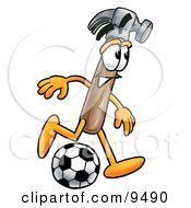 Clipart Picture Of A Hammer Mascot Cartoon Character Kicking A Soccer Ball by Toons4Biz