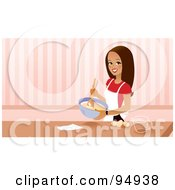 Pretty Brunette Woman Mixing Cake Mix In A Bowl