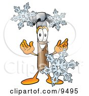 Clipart Picture Of A Hammer Mascot Cartoon Character With Three Snowflakes In Winter by Toons4Biz