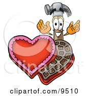 Clipart Picture Of A Hammer Mascot Cartoon Character With An Open Box Of Valentines Day Chocolate Candies by Toons4Biz
