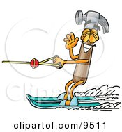 Clipart Picture Of A Hammer Mascot Cartoon Character Waving While Water Skiing by Toons4Biz