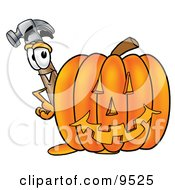 Clipart Picture Of A Hammer Mascot Cartoon Character With A Carved Halloween Pumpkin by Toons4Biz