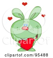 Royalty Free RF Clipart Illustration Of A Loving Green Bunny Holding A Red Heart