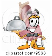 Heart Organ Mascot Cartoon Character Dressed As A Waiter And Holding A Serving Platter