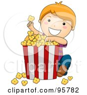 Cute Little Girl Eating A Giant Bucket Of Popcorn