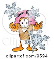 Clipart Picture Of An Ice Cream Cone Mascot Cartoon Character With Three Snowflakes In Winter by Toons4Biz