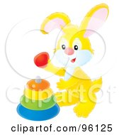 Royalty Free RF Clipart Illustration Of A Cute Yellow Bunny Rabbit Playing With A Baby Ring Toy