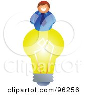 Royalty Free RF Clipart Illustration Of A Happy Creative Businessman On Top Of A Yellow Light Bulb by Prawny
