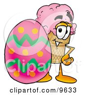 Ice Cream Cone Mascot Cartoon Character Standing Beside An Easter Egg