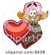 Ice Cream Cone Mascot Cartoon Character With An Open Box Of Valentines Day Chocolate Candies