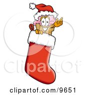 Clipart Picture Of An Ice Cream Cone Mascot Cartoon Character Wearing A Santa Hat Inside A Red Christmas Stocking by Toons4Biz