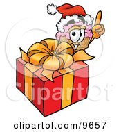Ice Cream Cone Mascot Cartoon Character Standing By A Christmas Present