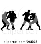 Silhouetted Boxers Fighting