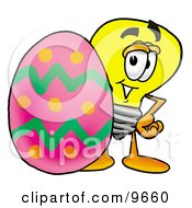 Clipart Picture Of A Light Bulb Mascot Cartoon Character Standing Beside An Easter Egg