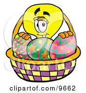 Clipart Picture Of A Light Bulb Mascot Cartoon Character In An Easter Basket Full Of Decorated Easter Eggs